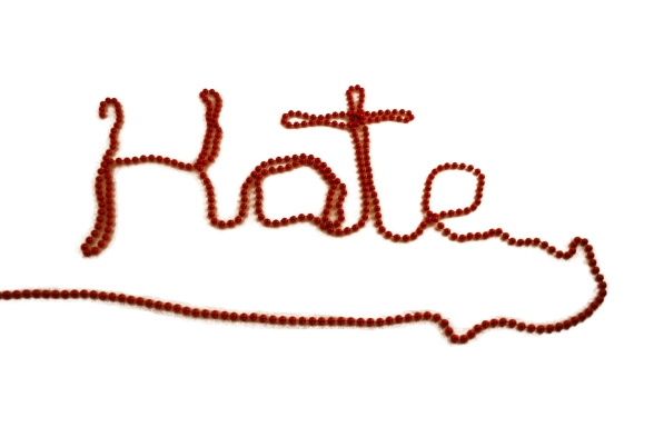 Hate written out in red beads